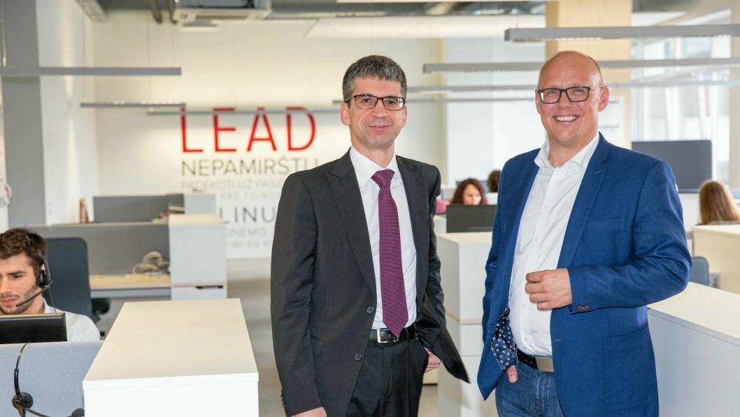 Adm. direktør Edvardas Liachovicius og kommunikasjonsdirektør Kristian Kaas Mortensen i Girteka Logistics skal doble antall sjåfører på tre år.