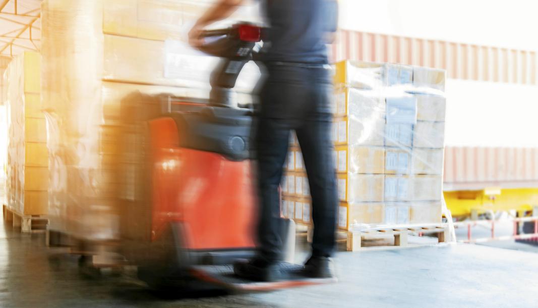 Motion blur of forklift driver unloading cargo pallets at warehouse Gaffeltruck. Stttebenstruck. Truck